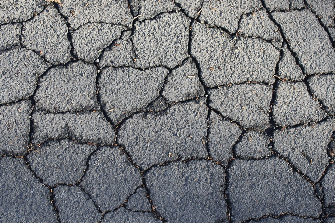 Cracked Asphalt Pavement Needing Repair